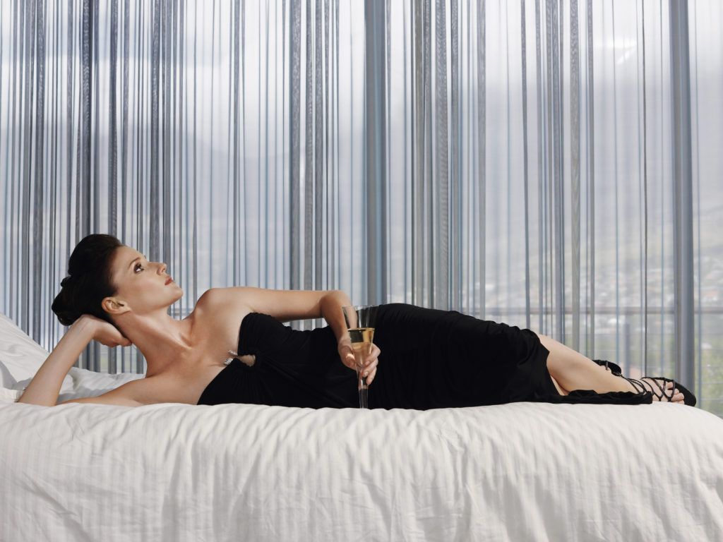 Stylish Woman Lying on Bed